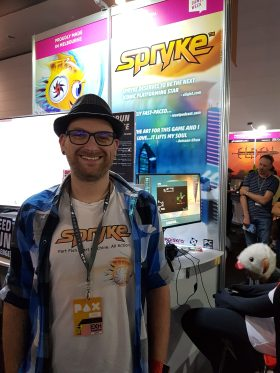 Spryke creator Dave Bleja stands in front of his game, due out in 2018